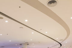 Beige ceiling mounted speaker bulbs. Beautiful beige ceiling mounted speaker bulbs Stock Photo