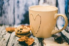 Beige Ceramic Heart Mug With Coffee Beside Cookie Food Stock Images