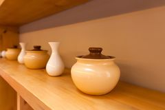 Pots and white small vases stock photography
