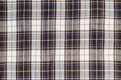 Beige checkered on fabric Stock Photos
