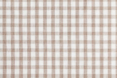 Beige checkered fabric. Tablecloth texture. Photo shot of beige checkered fabric. Tablecloth texture Stock Photography