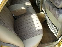 Beige checkered seats Royalty Free Stock Images