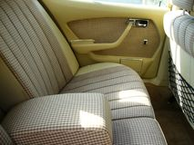 Beige checkered seats Stock Photography