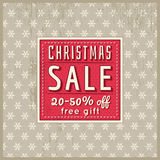 Beige christmas background and  label with sale offer, vector Stock Photos