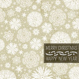 Beige christmas background with snowflakes and lab Royalty Free Stock Photo