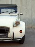 Beige Citroen 2cv. A beige Citroen 2cv from the 80's, partial frontal view royalty free stock photo