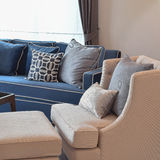 Beige classic sofa and blue pattern pillows in living room Royalty Free Stock Photos