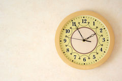 Beige clock on the wall. Photo with space for text. Royalty Free Stock Images
