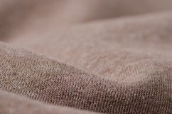 Beige clothing macro. Beige fabric clothing texture material textile macro Stock Images
