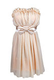 Beige cocktail dress with satin bow Royalty Free Stock Photography
