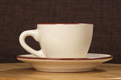 Beige coffee cup Stock Image