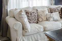 Beige color sofa and pillows in living room Stock Photos