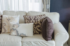 Beige color sofa and pillows in living room Stock Images