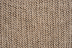 Beige color wool knitted fabric background texture. Clodeup Royalty Free Stock Images