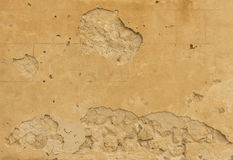 Beige colored damaged stone wall Royalty Free Stock Photos