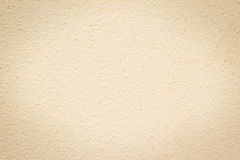 Beige colored house front, structured Stock Photography