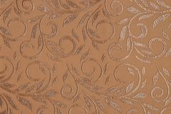 Beige colored patterned fabric texture. Details of the texture and weaving of beige fabric stock image
