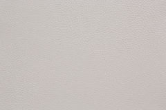 Beige coloured faux leather surface. Background. Royalty Free Stock Images