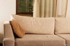Beige comfortable sofa in home interior Stock Images