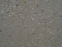 Beige concrete with multi color stone grit grain natural backgro. Und Royalty Free Stock Photo