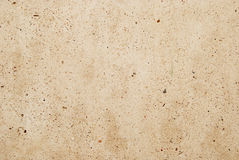 Beige concrete wall. Architectural texture of beige grained concrete wall Stock Photo