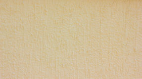Beige concrete wall. The texture of the wall is beige Stock Photos
