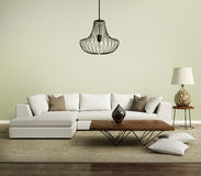 Beige contemporary modern sofa with lamp royalty free stock image