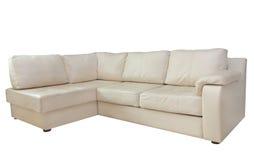Beige corner leather sofa.Isolated. Stock Photography