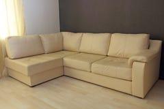 Beige corner leather sofa . Stock Photography