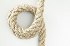 Beige cotton rope curl isolated on white color. Beige cotton rope curl isolated on  white color Stock Photos