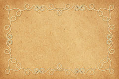 Beige cotton rope frame on craft paper Stock Image