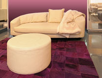 Beige couch. Modern beige leather couch in purple room interior Royalty Free Stock Photography