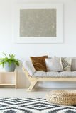 Beige couch, pouf and plants Royalty Free Stock Images