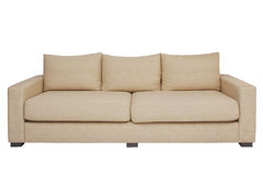 Beige couch on white Stock Images