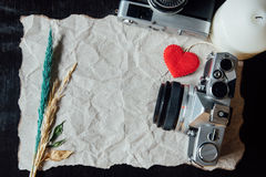 Beige crumpled paper with heart, candle, flower and vintage came Royalty Free Stock Photo