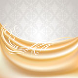 Beige curtain, silk tissue on gray background Royalty Free Stock Photography