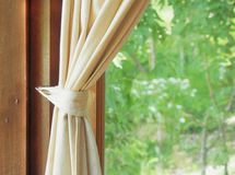 Beige curtain and  window view Royalty Free Stock Photos
