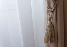 Beige curtains in a classic style Stock Images
