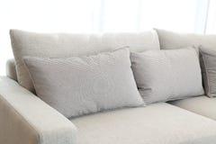 Beige cushion on grey sofa. Contemporary interior of Living room with beige cushion on grey sofa stock photo
