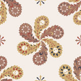 Beige decorative pattern. Vector colorful pattern with skulls in paisleys Stock Photos