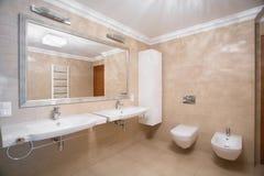 Beige designed toilet interior Stock Images