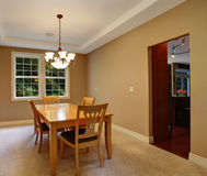 Beige dining room interior Stock Images