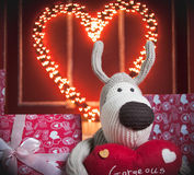 Beige dog with the red heart Stock Images