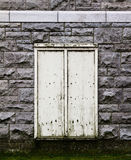 Beige Door in a stone wall. Stock Images