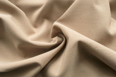 Beige drapery. Drapery of beige cotton fabric as a background Stock Photo