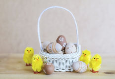 Beige easter eggs  in small white  basket Stock Photo