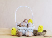 Beige easter eggs  in small white  basket Royalty Free Stock Image