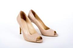 Beige elegant ladies` high-heeled shoes on a white background Stock Photo