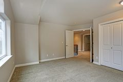 Beige empty room interior with closet royalty free stock photography