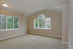 Beige empty room interior with closet. Beige empty room interior with built in closet, carpet floor and large window royalty free stock images
